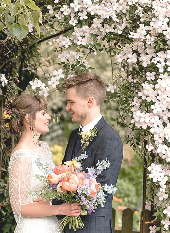 Marleybrook House couple standing under flower arch photographer Will Patrick